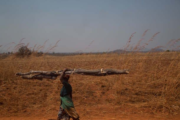 Girl Up - woman carrying wood Malawi