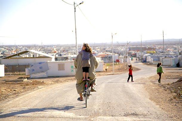 Girl on back of bike
