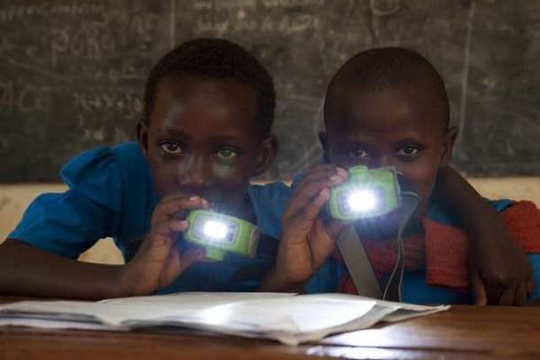 Nuru Energy boys with light