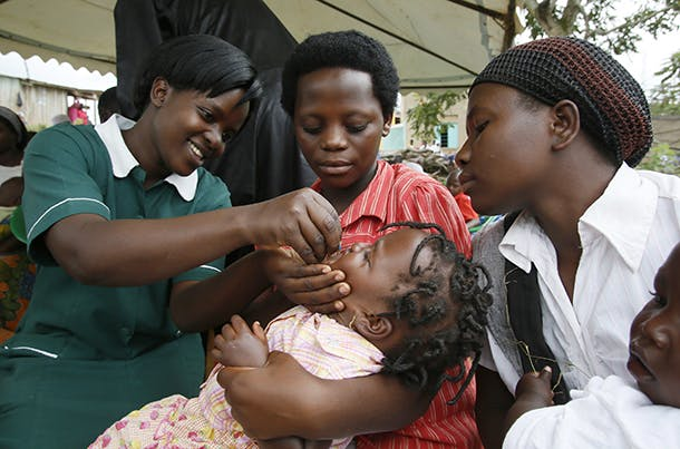 A health worker administers the polio vaccine during Family Health Day; a campaign supported by UNICEF, in Nabingoola, Uganda, Friday, Oct. 26, 2012. (Stuart Ramson/Insider Images for UN Foundation)