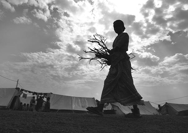 Sri Lankan carrying sticks