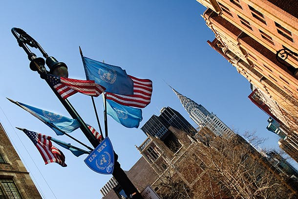 American and UN Flags flying on UN Way near the Chrysler building in New York City. Image shot 03/2008. Exact date unknown.