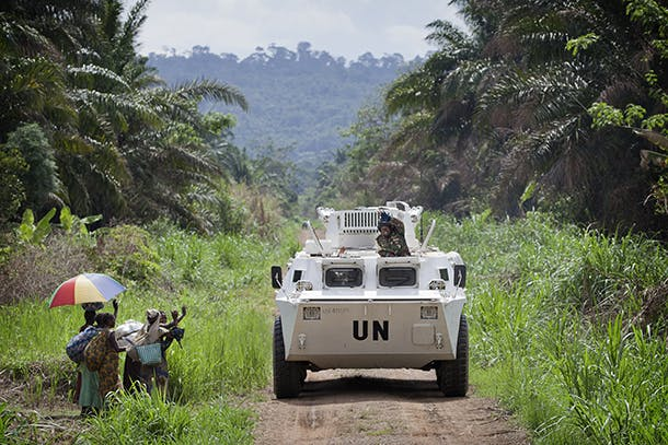 A MONUSCO APC is greeted by local residents near the front line in the Beni region where the UN is backing the FARDC in an operation against ADF militia, the 13th of March 2014.   © MONUSCO/Sylvain Liechti