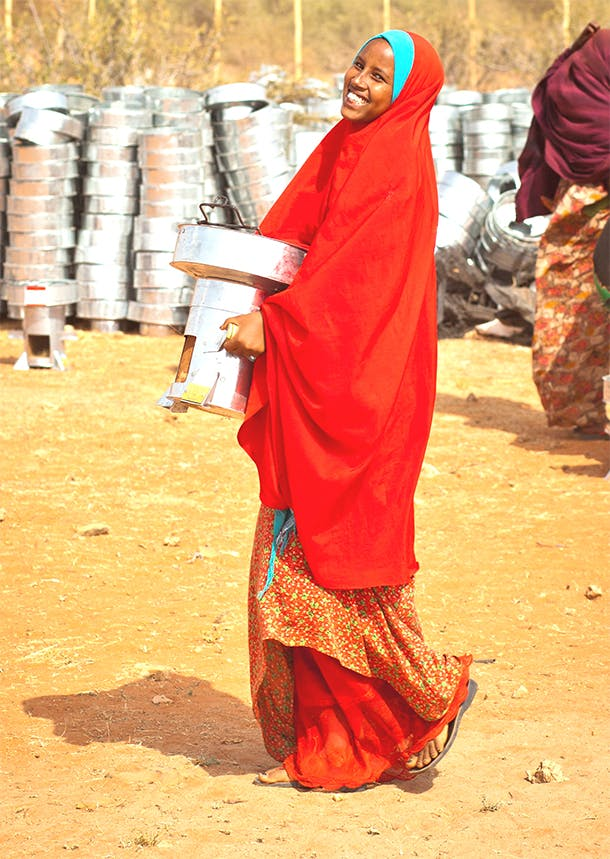 Woman carrying stove
