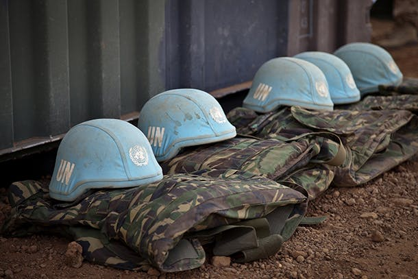 Blue helmets from the Dutch Engineering Company serving with MINUSMA are seen sitting on the ground at the under construction military camp in Gao, Northern Mali. The Dutch Contingent will be effective in the next weeks and will consist in 380 soldiers from Logistic Team, Special Forces and 6 Apache helicopters.