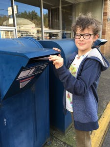 Abner mailing letters to leaders about climate action.