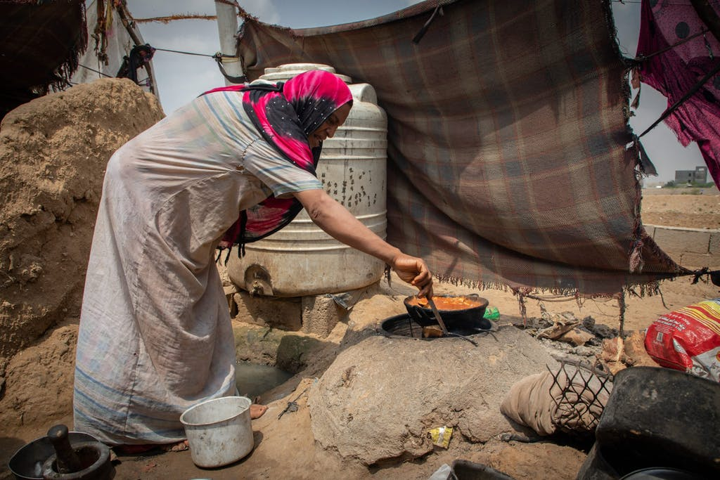 Woman prepares a meal
