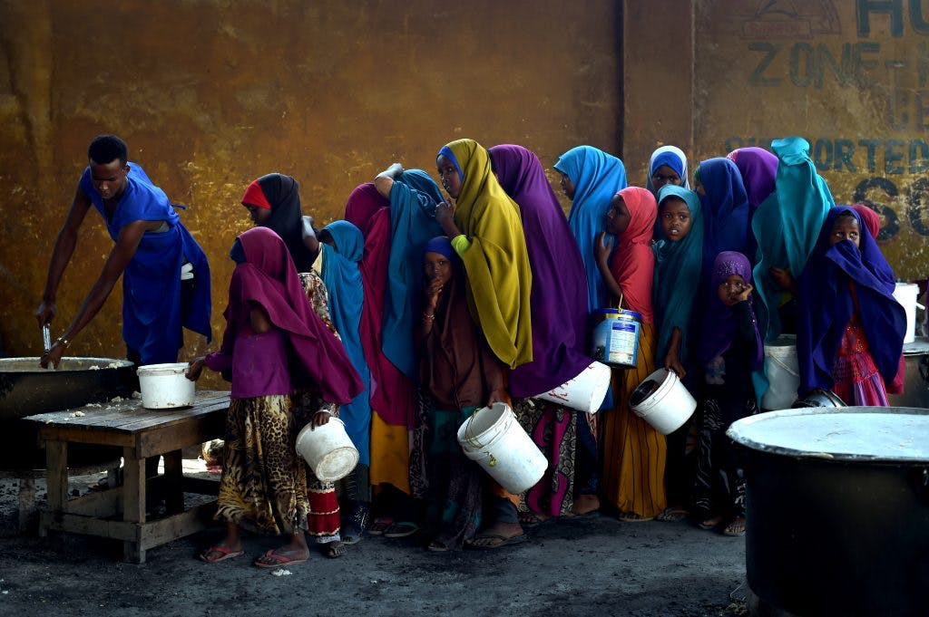 Young girls line up at a feeding centre in Mogadishu.