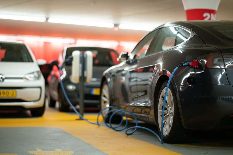 Electric cars charge up in a garage