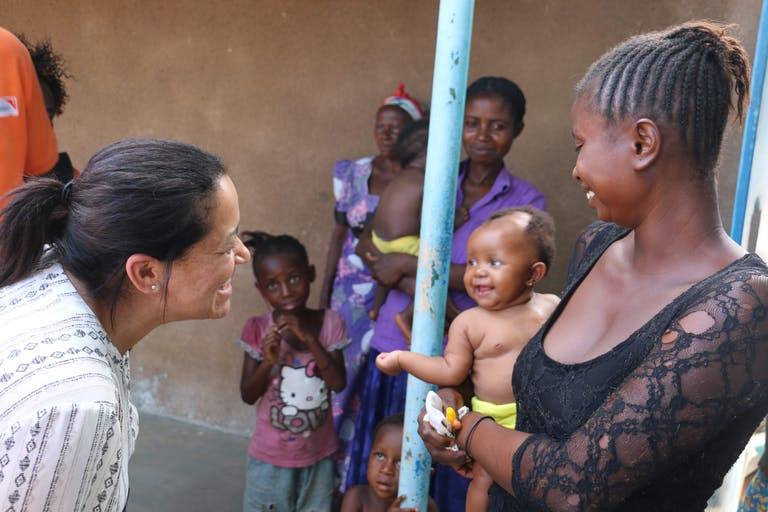 Valerie Guarnieri greets an infant in the Democratic Republic of the Congo