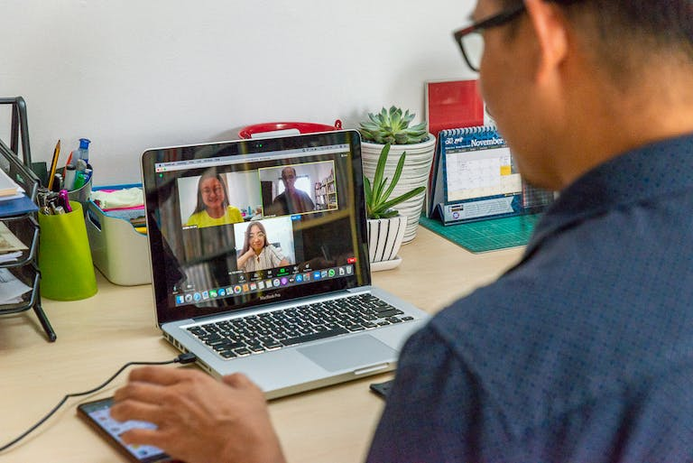 A university student video chats with his peers.